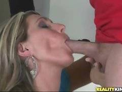 This big tited blonde milf knows how to slurp dick and she does her best.