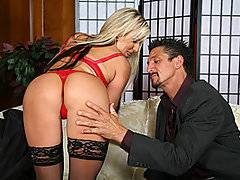 Big titty blond MILF Carolyn Reese is the kind of harlot who is impressed by superficial things like money and power.  She comes across older stud Tommy Gunn, who looks so wealthy and respectable in his suit that Carolyn immediately grows wet between her legs.  She tries to play it cool at first, but finally she can\'t help herself any longer - she needs some of that alpha male cock!  She strips down to her bra, panties and stockings, leaving her high heels on as she bends over the back of the sofa and tempts Tommy with her beautiful butt.  Soon she\'s got Tommy\'s big cock thrust down her throat, and then he stuffs it into her wet pussy.