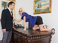 Now this is one stunning MILF!  Beautiful and busty blonde Brandi Edwards is disappointed with the performance of her employee, Talon.  She calls him into her office, intending on giving him a good dressing down.  However, when the attractive stud walks into the room, she finds herself overwhelmed with lust.  She teases him by spreading her legs and showing off her pantie-clad vagina.  Soon she is naked except for her high heels, looking up at him through her glasses while she blows him.  She takes a hard pounding, riding the dick and getting nailed from behind while she is bent over her own desk.  Finally Brandi swallows a fat load.