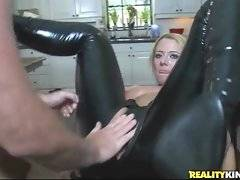 A whore is wearing black sexy pant with a hole for cock