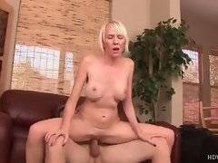 Pretty mature chick is jumping on nice thick cock.